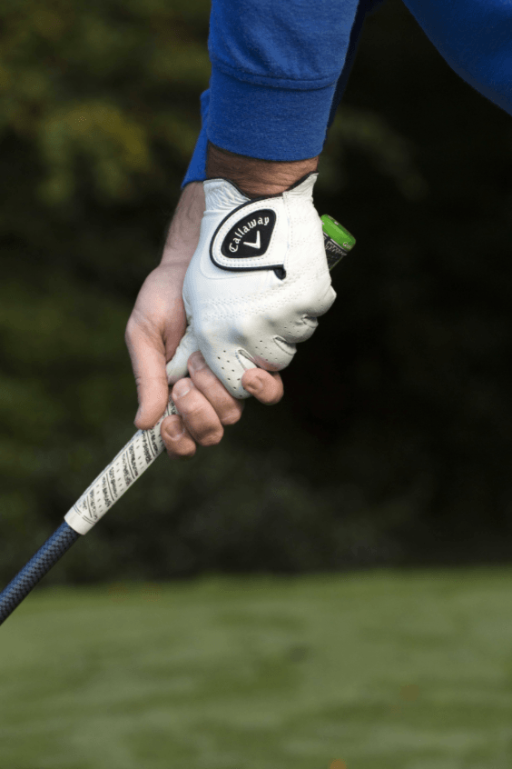 A lad wearing Callaway glove is holding the golf club at Mount Juliet